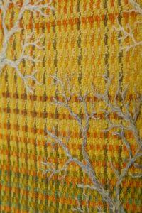 Warp ikat embroidery forest golden light motive
