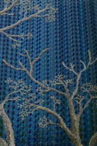Warp ikat embroidery forest winter motive